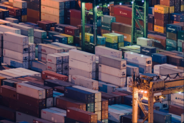 An aerial view of shipping containers at night representing Data Storage services by CyberNorth.